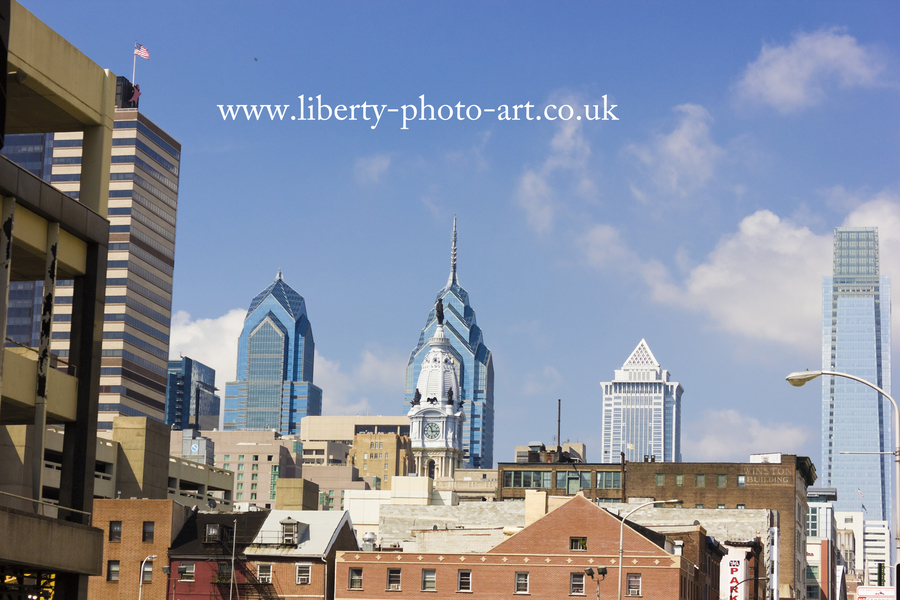 Striking view of the Center City skyline of Philadelphia including One Liberty Place, Two Liberty Place, Comcast Center, BNY Mellon Center & statue of William Penn atop City Hall