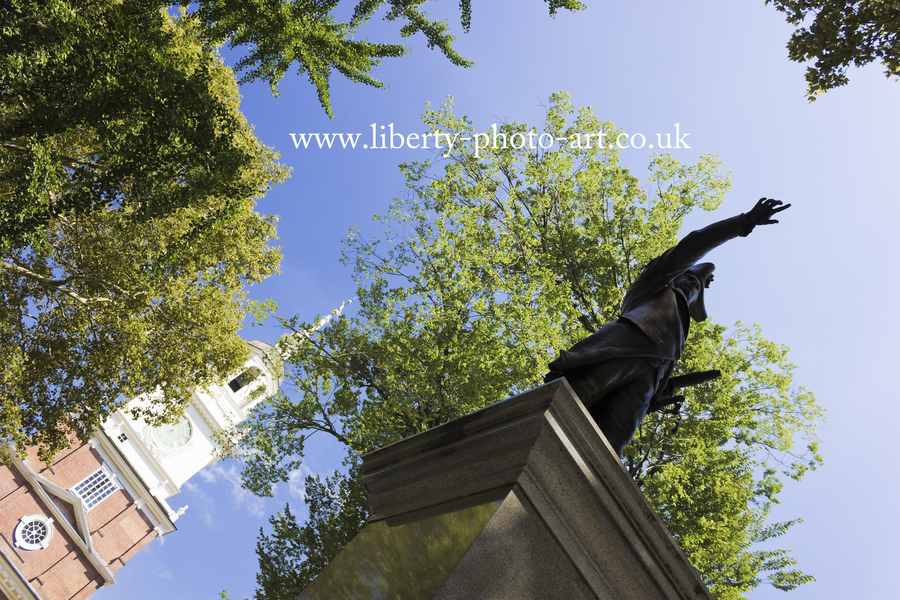 Creative summer view of the bronze statue of Commodore John Barry with the tower and spire of Indpendence Hall behind, Old City, Philadelphia