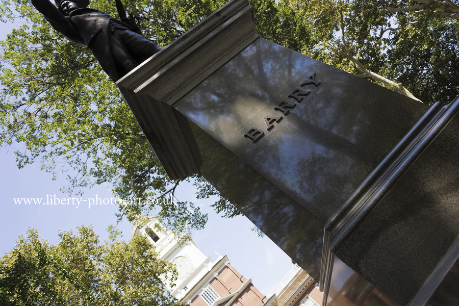 Creative view of the bronze statue of Commodore John Barry with Independence Hall behind, Old City, Philadelphia