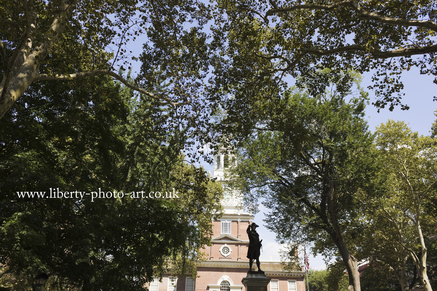 Summer view of Independence Hall fronted by the statue of Commodore John Barry in Independence Square, Old City, Philadelphia