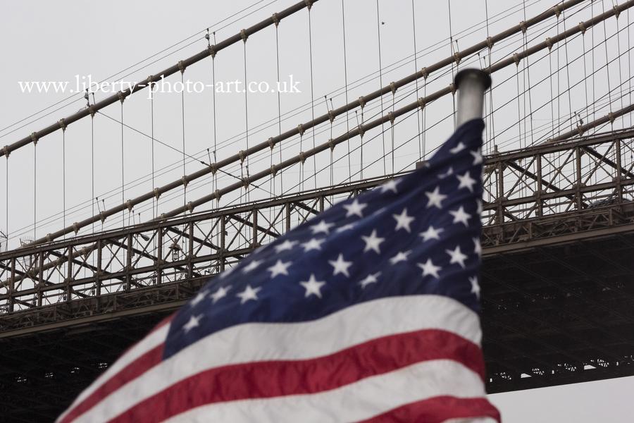 Patriotic view of the historic Brooklyn Bridge, New York City
