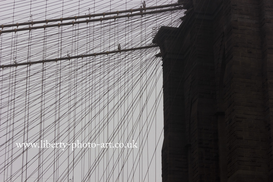 Striking view of the steel cables of the historic Brooklyn Bridge, New York City