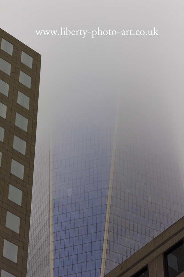 Striking view of the One World Trade Center skyscraper in dense fog, Lower Manhattan, New York City